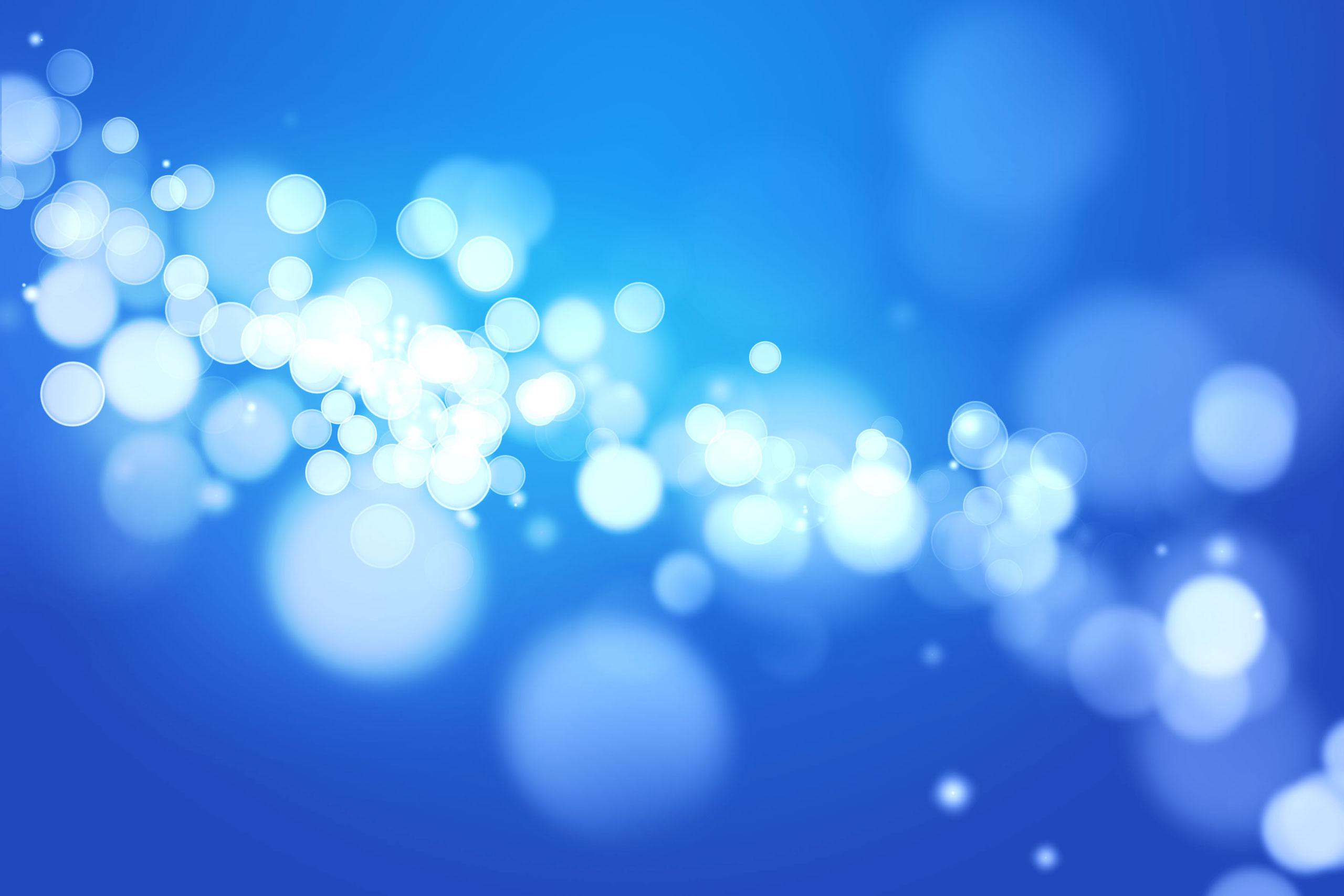 Голубой фон со светящимися круглыми бликами.