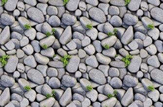 Фотография текстура галька серого цвета с зелёной травой