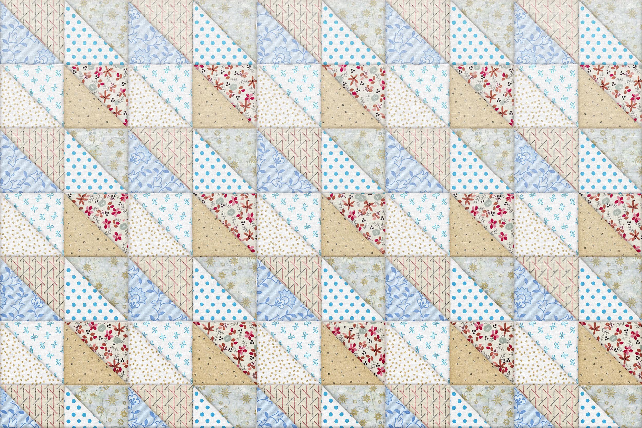 Изображение одеяла из текстильных треугольников.