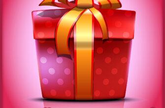 Красная подарочная коробка с золотой лентой на розовом фоне.
