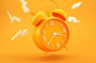 Картинка с текстом доброе утро с будильником оранжевого цвета.