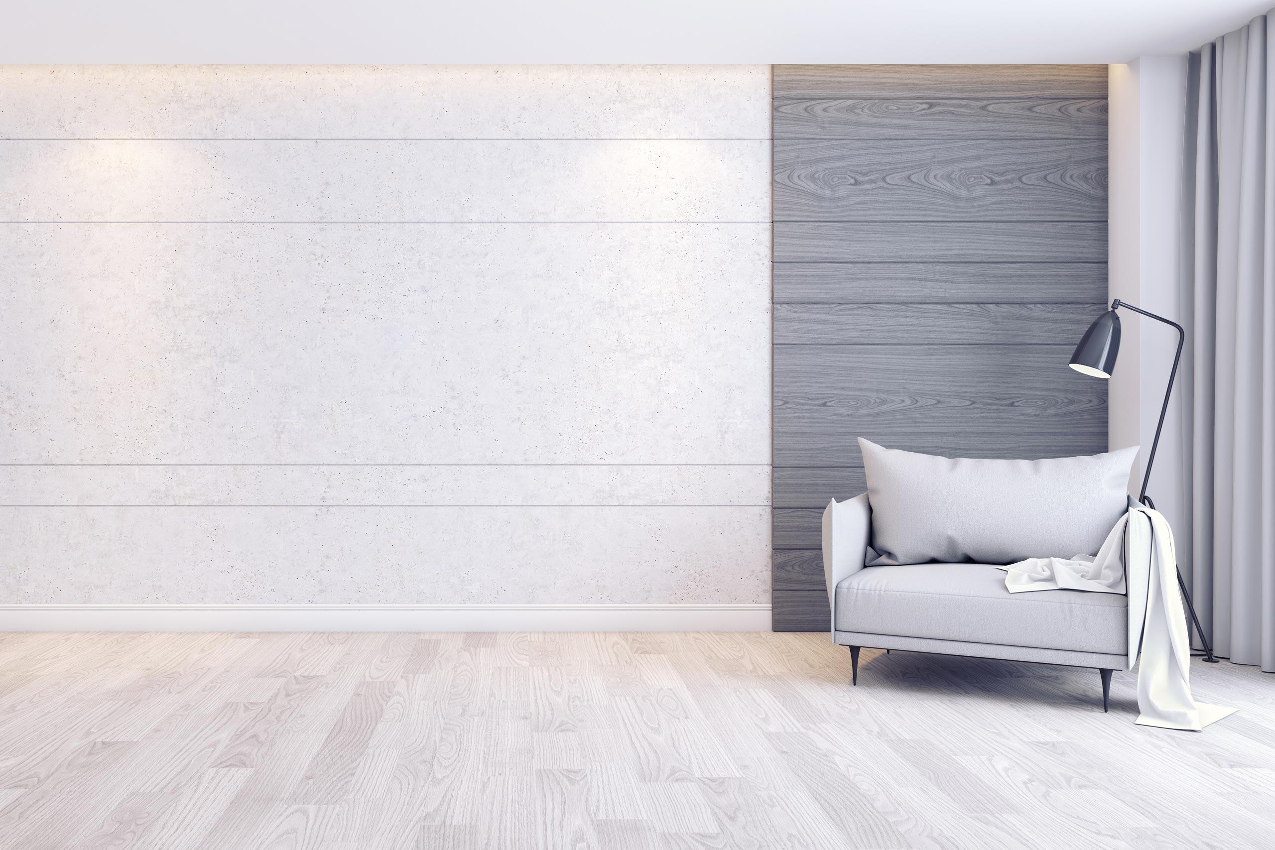 Серый фон для фотошопа комната с креслом и светильником у стены.