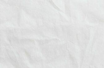 Картинка с мятым листом бумаги белого цвета с бежевым оттенком.