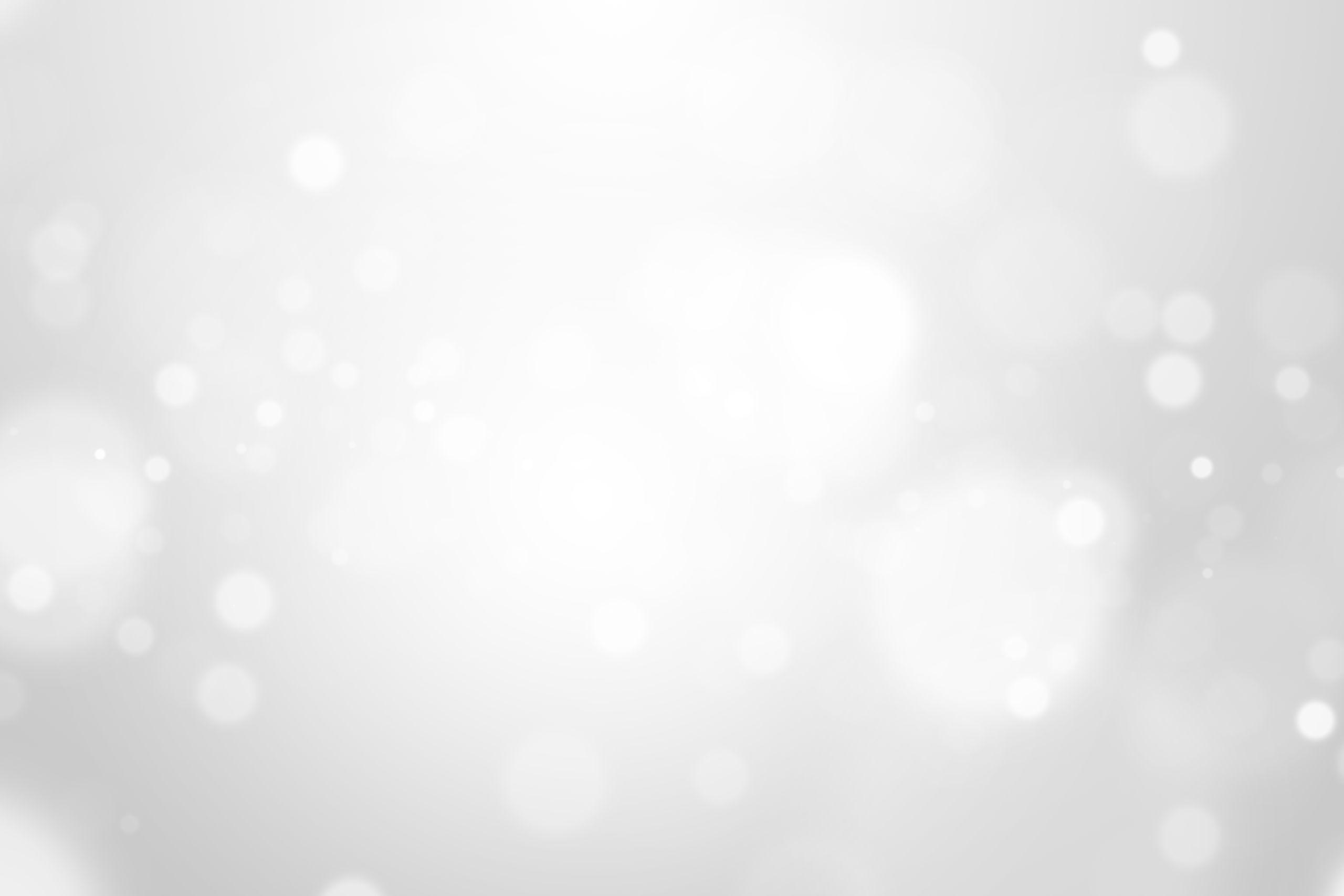 Светло-серый фон для фотошопа с круглыми бликами.