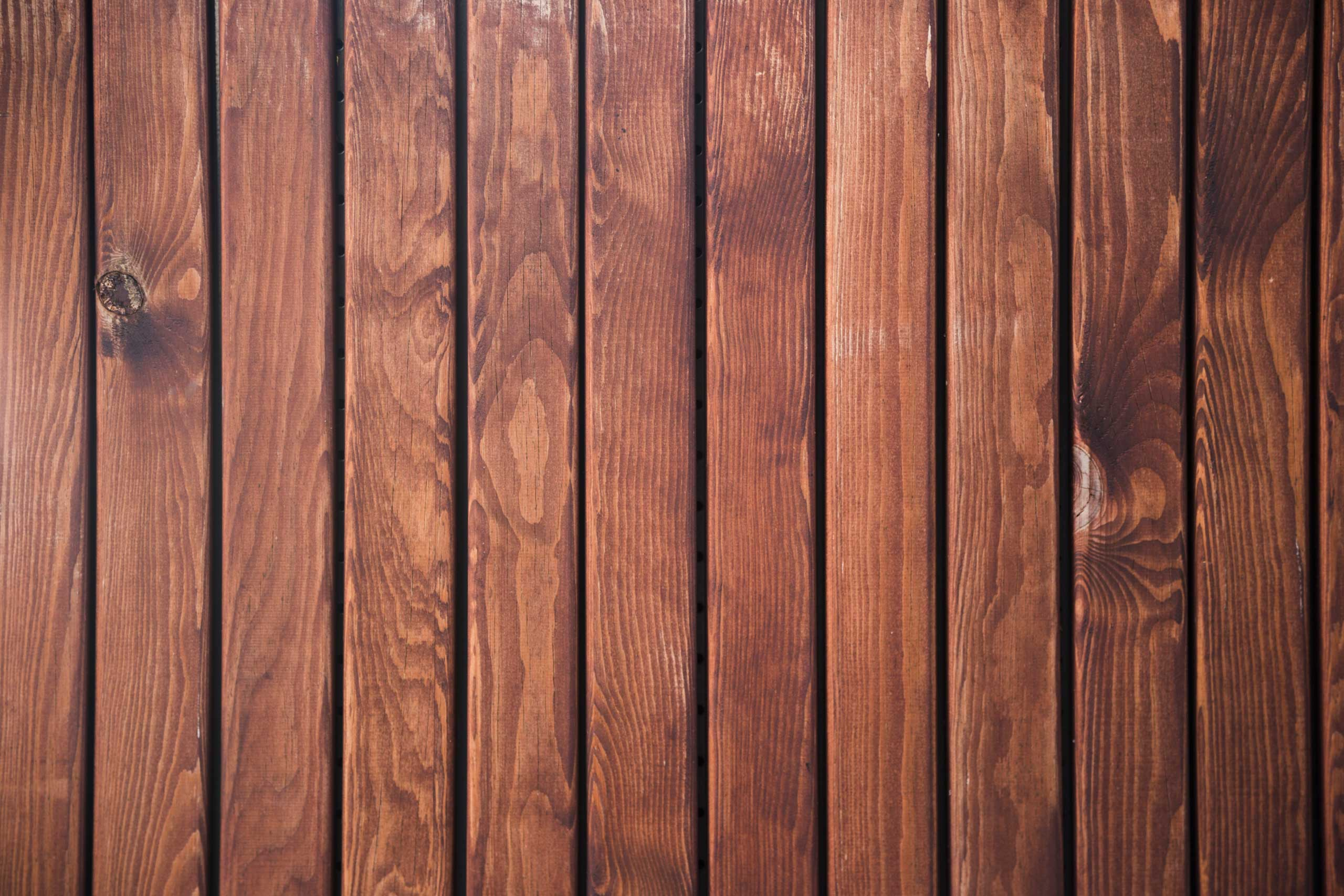 Коричневая текстура деревянные рейки на стене.