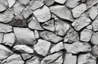 Монохромная фотография - текстура каменная стена серого цвета.