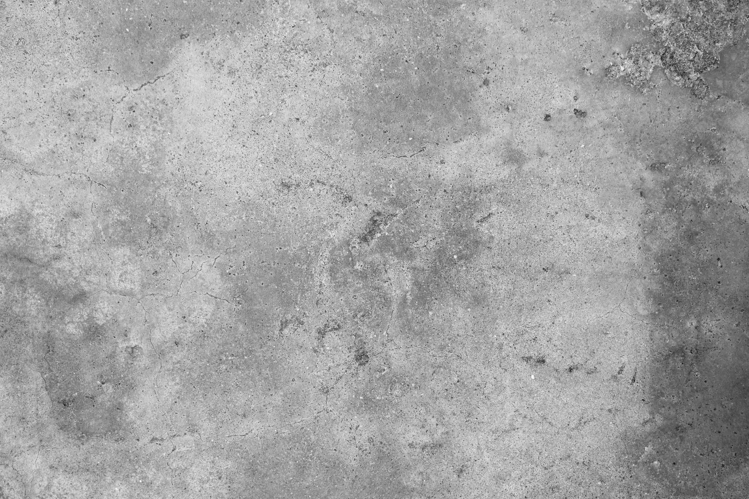 Фотография серой бетонной стены.